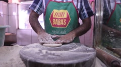 Man Making Roti in Singapore's Little India Stock Footage