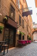 Old pub in a tiny alley in the city center of Ferrara Italy - stock photo