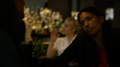 4K Female friends having serious conversation in city bar. Stock Footage