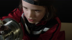 4k shot of a cute child working in laboratory-Exploring a Gear spinning Stock Footage