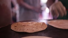 Man Grilling Roti in Singapore's Little India Stock Footage