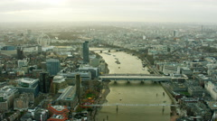 Aerial view of bridges spanning the River Thames London Stock Footage