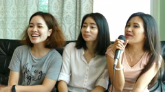 Girls sing a song together Stock Footage