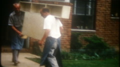 3437 moving men move furniture from house to house-vintage film home movie - stock footage