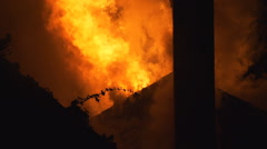 Inferno of house fire at night Stock Footage