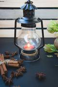 Candlestick in the form of an oil lamp Stock Photos
