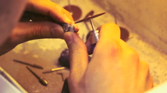 Dental technician grinds metal teeth for false dental prosthesis close up Stock Footage