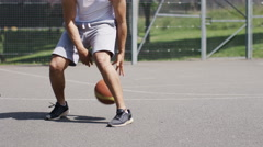 4K Man dribbling a basketball with skill, in slow motion - stock footage