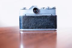 Back view of vintage rangefinder camera background - stock photo