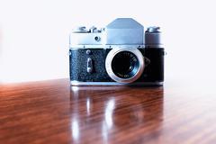 Vintage rangefinder camera background - stock photo