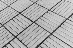 Horizontal black ad white diagonal city tile background backdrop Stock Photos