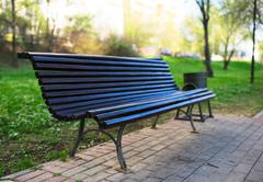 Diagonal park bench bokeh background with light leak Stock Photos