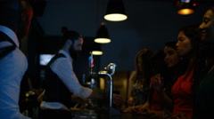 4K Happy mixed ethnicity female friends drinking at the bar in nightclub.  Stock Footage