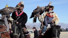 GOLDEN EAGLE HUNTER FESTIVAL HORSEMEN PORTRAIT CHILD TOURISTS - stock footage