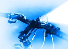 Horizontal bicycle blue flashlight bokeh background - stock photo