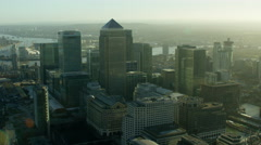 Aerial view of buildings in Canary Wharf beside River Thames London Stock Footage