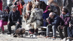 GOLDEN EAGLE HUNTER FESTIVAL FUR HAT COAT PORTRAIT TOURISTS Stock Footage