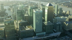 Aerial view of buildings in Canary Wharf River Thames London Stock Footage