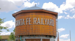 Wide Shot of a Rustic Wooden Water Tower in the Santa Fe Railyard Stock Footage