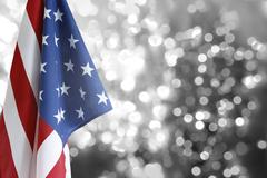 USA flag in front of blurry circles - stock photo