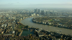 Aerial view of the River Thames by city buildings London UK Stock Footage