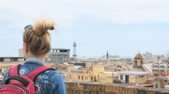 Tourist girl stand at observation deck at top cathedral in Spain Stock Footage