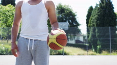 4K Man with basketball takes a free throw, in slow motion, with space for text Stock Footage
