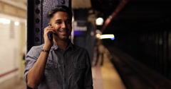 Young southeast Asian Indian man in City talking on cell phone Stock Footage