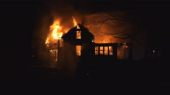 Two-story house consumed by fire Stock Footage