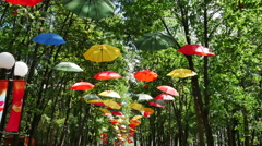 Umbrellas Art Facility in a City Park Stock Footage