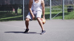 4K Man runs up to a basketball and starts dribbling with skill, in slow motion - stock footage