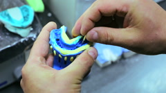 Dental technician making imprint of teeth for false dental prosthesis Stock Footage
