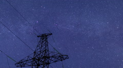 Power transmission line tower on a starry sky Stock Footage