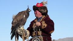 GOLDEN EAGLE HUNTER FESTIVAL HORSEMAN FUR COAT PAN UP PORTRAIT Stock Footage
