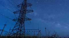 Power transmission line tower on a starry sky - stock footage
