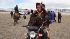 GOLDEN EAGLE HUNTER FESTIVAL MOTORCYCLE PORTRAIT Stock Footage