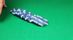 Many poker chips falling on green casino table - stock footage