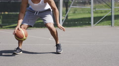 4K Casual basketball player dribbles the ball, in slow motion, with text space Stock Footage