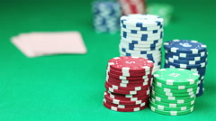 Poker player shows his good pair hand for win and doing bet Stock Footage