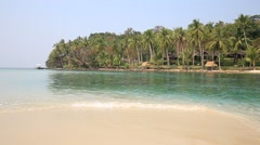 Tropical sand beach with exotic coconut palm trees near sea water, Thailand Stock Footage