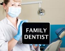 Technology, internet and networking in medicine concept - femail dentist holding Stock Photos