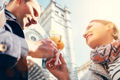 A couple in love eat ice-cream during their Italian voyage Stock Photos