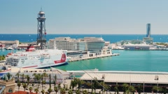 Sea port of Barcelona. On the roads there is a huge cruise liner Stock Footage
