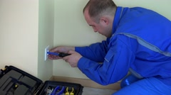 Professional electrician man working with screwdriver on outlet Stock Footage