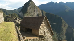 High angle view of a restored hut at machu picchu on a sunny morning Stock Footage