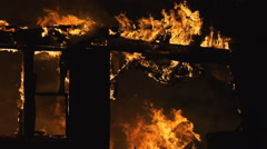 Fire burns through remainder of house Stock Footage