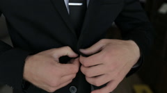 Buttoning a Jacket. Stylish Man in a Suit Fastening Buttons on His Jacket Stock Footage