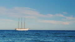 Sailing ship with three masts in the sea - stock footage