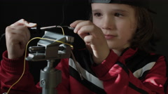 4k shot of a cute child working in laboratory - Soldering Wires Stock Footage