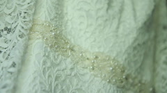 Close up detail of a brides wedding dress Stock Footage